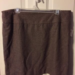 The limited short lined brown plaid skirt. Size 12